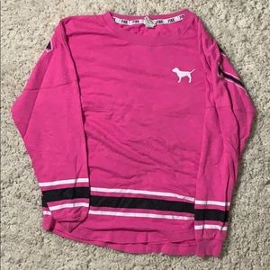 A pink shirt with black and white stripes